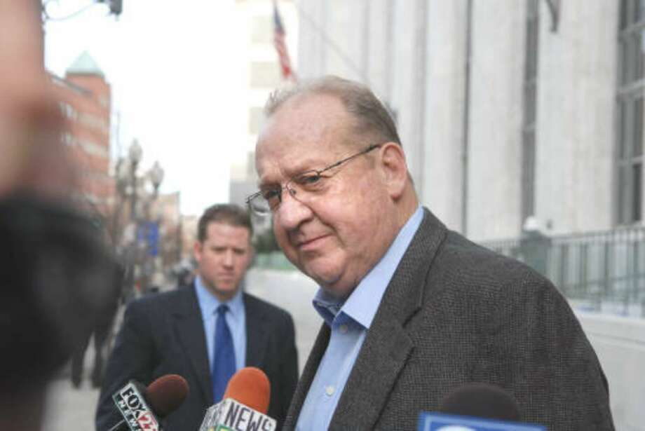 Wolfgang Hammer, former head of the Hotel and Bartenders Union, talks with the media outside the federal courthouse in Albany, N.Y., Thurs., Nov. 12, 2009, following his testimony in former Sen. Joseph L. Bruno's trial on felony corruption charges.  (Paul Buckowski / Times Union)