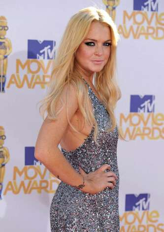 Lindsay Lohan arrives at the MTV Movie Awards in Universal City, Calif., on Sunday, June 6, 2010. (AP Photo/Chris Pizzello) Photo: Chris Pizzello