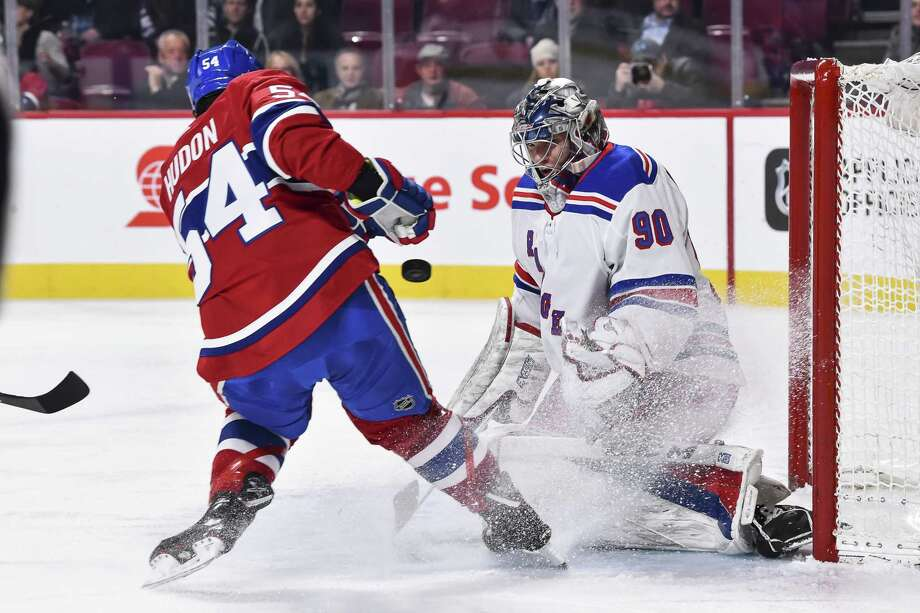 MONTREAL, QC - FEBRUARY 22:  Goaltender Alexandar Georgiev #90 of the New York Rangers defends his net in his first ever NHL game against Charles Hudon #54 of the Montreal Canadiens during the NHL game at the Bell Centre on February 22, 2018 in Montreal, Quebec, Canada.  (Photo by Minas Panagiotakis/Getty Images) Photo: Minas Panagiotakis / 2018 Getty Images