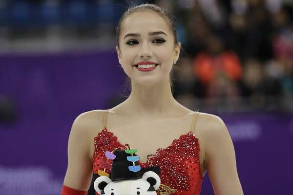 Alina Zagitova of the Olympic Athletes of Russia poses for a photo after winning the gold medal during the women's free figure skating final in the Gangneung Ice Arena at the 2018 Winter Olympics in Gangneung, South Korea, Friday, Feb. 23, 2018. (AP Photo/David J. Phillip)