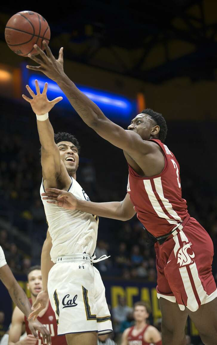 Washington State's Robert Franks, right, lays up a shot beyond the reach of California's Justice Sueing during the first half of an NCAA college basketball game Thursday, Feb. 22, 2018, in Berkeley, Calif. (AP Photo/D. Ross Cameron)