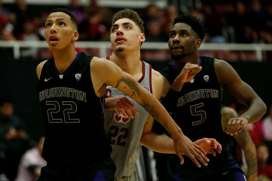 Stanford Cardinal's Reid Travis (22) is guarded by Washington Huskies Dominic Green (22) and Jaylen Nowell (5) during the second half of a basketball game between the Cardinal and Washington Huskies at Maples Pavilion, Thursday, Feb. 22, 2018, in Stanford, Calif. The Cardinal won 94-78. Photo: Santiago Mejia, The Chronicle