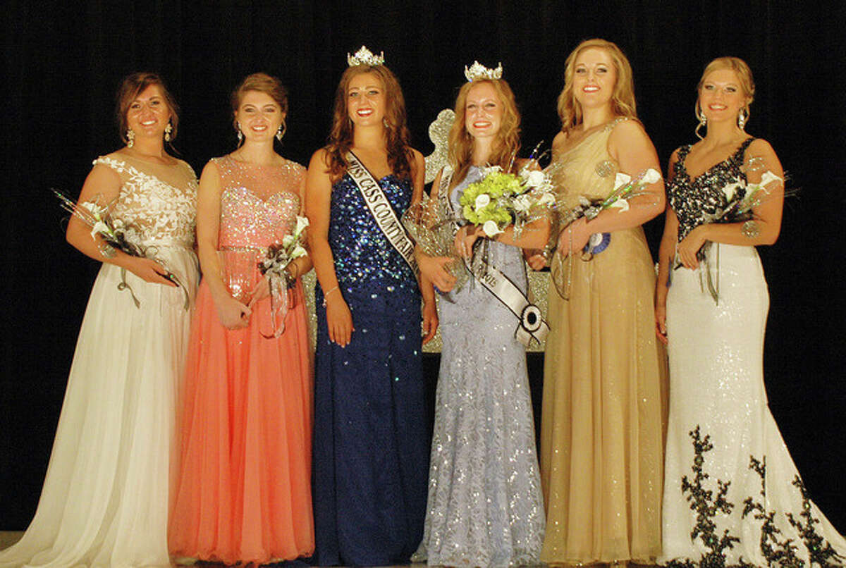 Sharing the stage after the Cass County Fair Queen Pageant on Monday are Miss Congeniality Caseelynn Johnston (from left), Miss Photogenic and second runner-up McKenzie Stephens, 2014 Miss Cass County Audrey Brauer, Peoples Choice and 2015 Miss Cass County Aileana Rawlins, first runner-up Courtney Bedtka and Madeline Swan.
