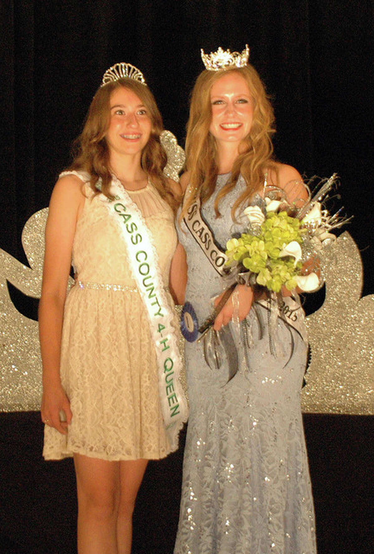 Beth Warden of Beardstown, the 2015 4-H Queen, and 2015 Miss Cass County Queen Aileana Rawlins of Beardstown show their winning smiles after being crowned during the Cass County Fair Queen Pageant on Monday. The fair continues through Saturday in Virginia.