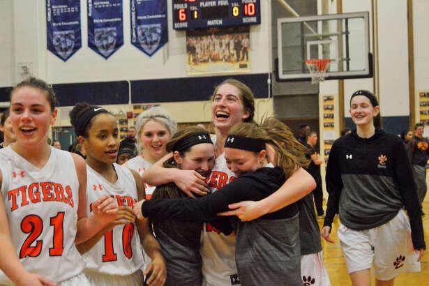 EHS guard Kate Martin hugs teammates Lauren Taplin and Rachel Vinyard after the win.