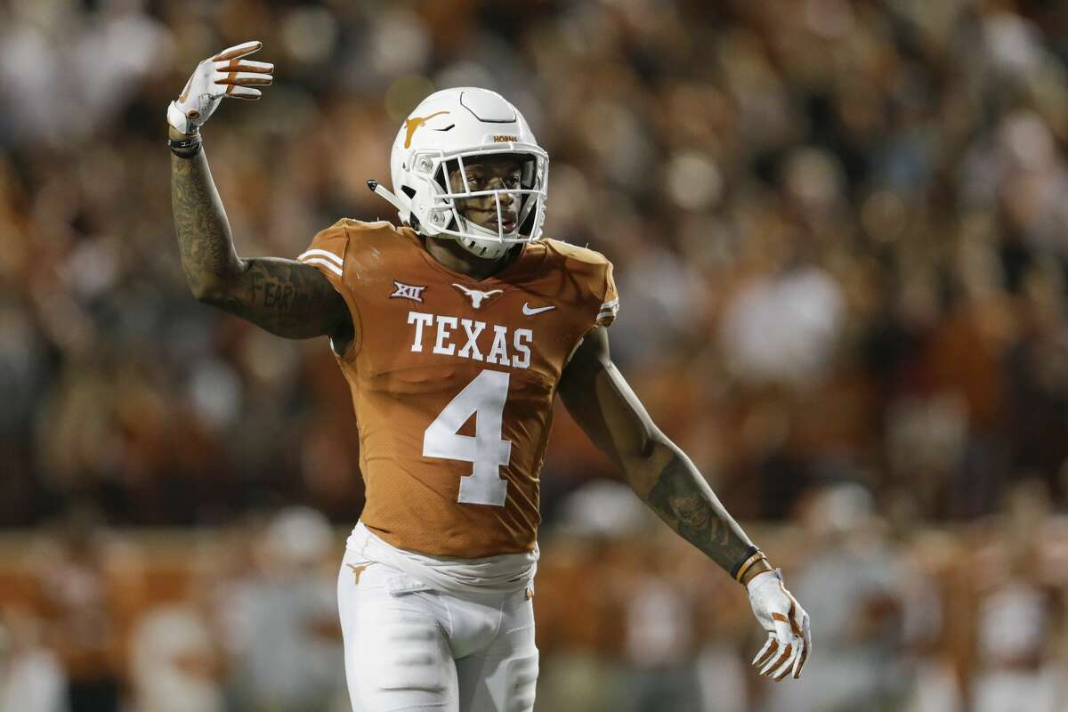 AUSTIN, TX - NOVEMBER 24: DeShon Elliott #4 of the Texas Longhorns calls for the crowd to make noise in the second half against the Texas Tech Red Raiders at Darrell K Royal-Texas Memorial Stadium on November 24, 2017 in Austin, Texas. (Photo by Tim Warner/Getty Images)