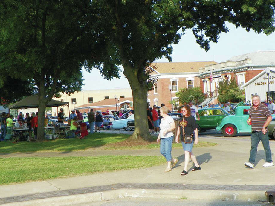 Beardstown's downtown square bustles with activity during the 2014 Beardstown Cruise-In. The seventh annual car-centric event happens Saturday evening. Photo: Photo Provided By Beardstown Main Street