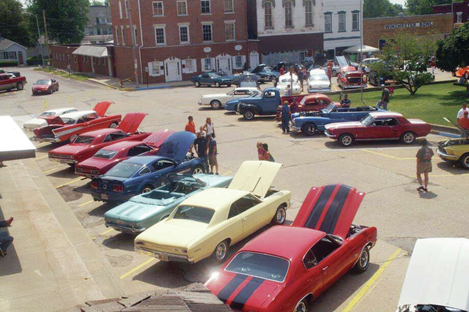 Participants stroll among the cars on display in July 2014 during the first Winchester Community Picnic. The picnic, inspired by a burgoo event once popular in the town, returns Saturday for a second year. Photo: Photos Provided By Winchester Community Picnic