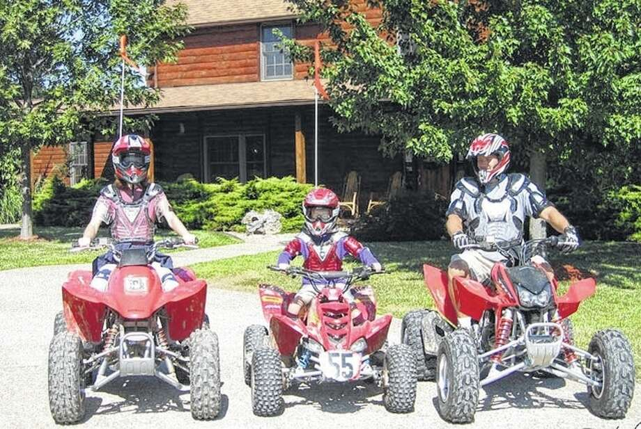 Photo provided A family gears up to ride all-terrain vehicles at Harpole's Heartland Lodge.