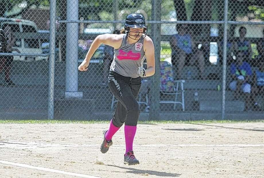 Tri-County All-Star Morgan Hoots hustles down the baseline during a game against Evergreen Park at the Little League Softball State Tournament Friday in Beardstown. Photo: Rob Evans | Journal-Courier