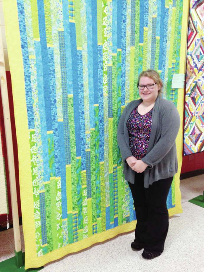 "Victoria Ranson's quilt ""Hopes of Stripes"" won the child/teen category during the 2014 River Country Quilt Show at Jacksonville High School. Photo: Photo Provided"