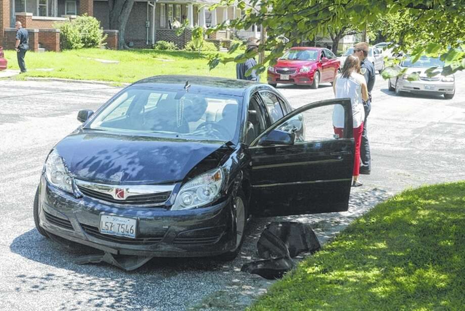 A 16-year-old girl was treated for minor injuries at the scene of a two-vehicle accident at the intersection of South Fayette Street and Beecher Avenue about 12:15 p.m. Wednesday. No other injuries were report and no citations were issued. Photo: Nick Draper | Journal-Courier