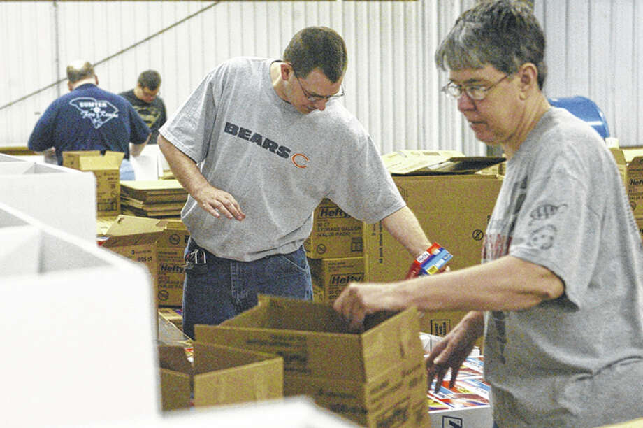Elm City Center workers pack Hefty bag display boxes for Reynolds. Elm City Center serves about 175 people, many of whom have directly benefited from the Americans with Disabilities Act. Photo: Greg Olson | Journal-Courier