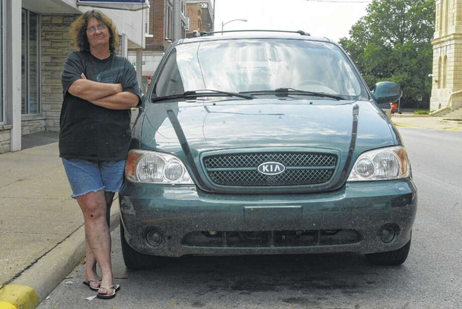 Tammy Dorzab has been unable to get a title for the van she bought from Morgan County Autoplex. The state is investigating similar reports from others who bought vehicles at the South Jacksonville dealership. Photo: Nick Draper | Journal-Courier