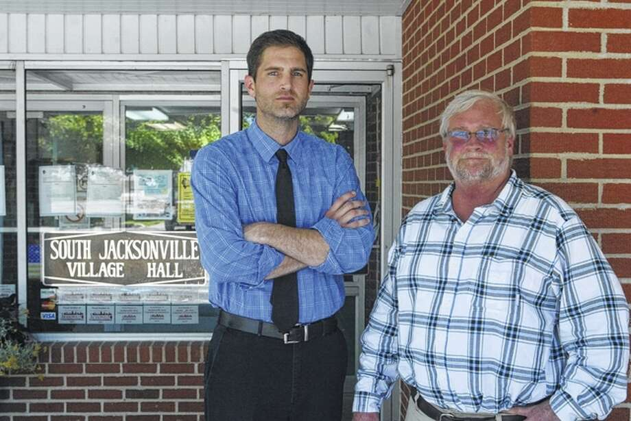 Tyson Manker (left) and Mike Woodyard stand in front of South Jacksonville Village Hall. Manker and Woodyard have received an Illinois Courage Award in recognition of their efforts to increase transparency in local government. Photo: Bre Linstromberg Copper | Journal-Courier