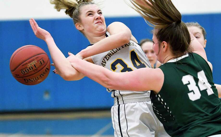 Averill Park's Kelsey Wood, left, is fouled by Hudson Falls' Jana DePalo during the first half of a girls' Section II Class A high school basketball game Thursday, Feb. 22, 2018, in Averill Park, N.Y. (Hans Pennink / Special to the Times Union) Photo: Hans Pennink / Hans Pennink