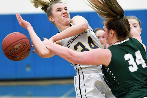 Averill Park's Kelsey Wood, left, is fouled by Hudson Falls' Jana DePalo during the first half of a girls' Section II Class A high school basketball game Thursday, Feb. 22, 2018, in Averill Park, N.Y. (Hans Pennink / Special to the Times Union)