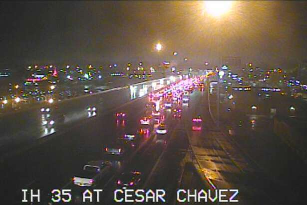 Heavy rain has caused minor flooding along Interstate 35 Friday morning, causing some backup.