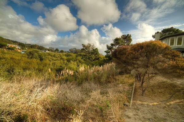 Asking $99,900, this lot in El Granada is located on a cul-de-sac steps from coastside hiking trails that go to the beach and the harbor.