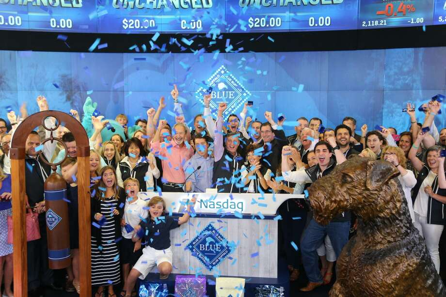 "Blue Buffalo ""herd members"" ring the opening bell for the Nasdaq on Wednesday, July 22, 2015, marking the initial public offering of stock for the premium pet food maker based in Wilton, Conn. Photo: Photo Courtesy Nasdaq / 2015, The NASDAQ OMX Group, Inc. All Rights Reserved."