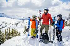 family skiing stock image