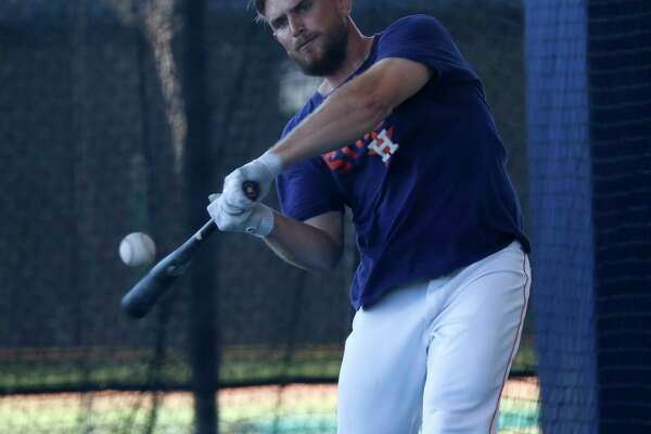 Houston Astros catcher Max Stassi (12) hits in the batting cages during spring training at The Fitteam Ballpark of the Palm Beaches, Friday, Feb. 23, 2018, in West Palm Beach.