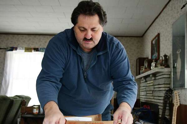Joseph Lestingi sorts through paperwork on Tuesday, Jan. 30, 2018, at his home in Clemons, N.Y.  (Madison Iszler/Times Union)
