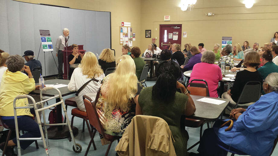 Area residents attended a community hearing Thursday to speak out against Illinois Gov. Bruce Rauner's proposed change to the state's Community Care Program.