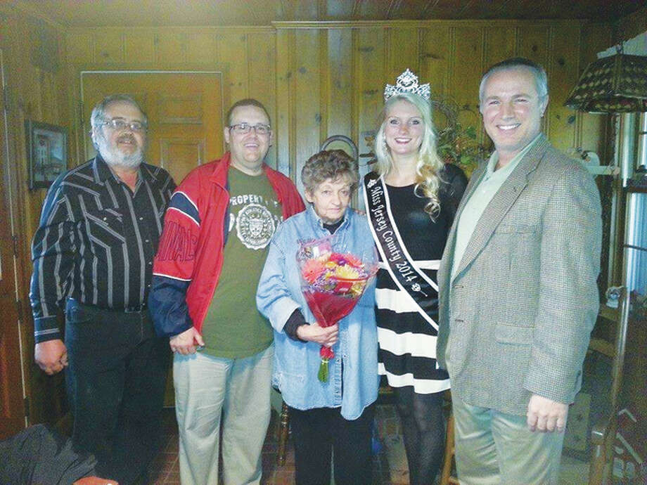 """""""Madame"""" Parade Marshal Martha Harpstrite, center, with, from far left, Jersey County Fair Vice President Dave Pille, JCHS Educator and Theater Director Brett Beauchamp, 2014-15 reigning Miss Jersey County Lauren Kight and Jersey County Fair Board Director Alex Foster. The Merchants Parade will begin at 6 p.m. Tuesday."""
