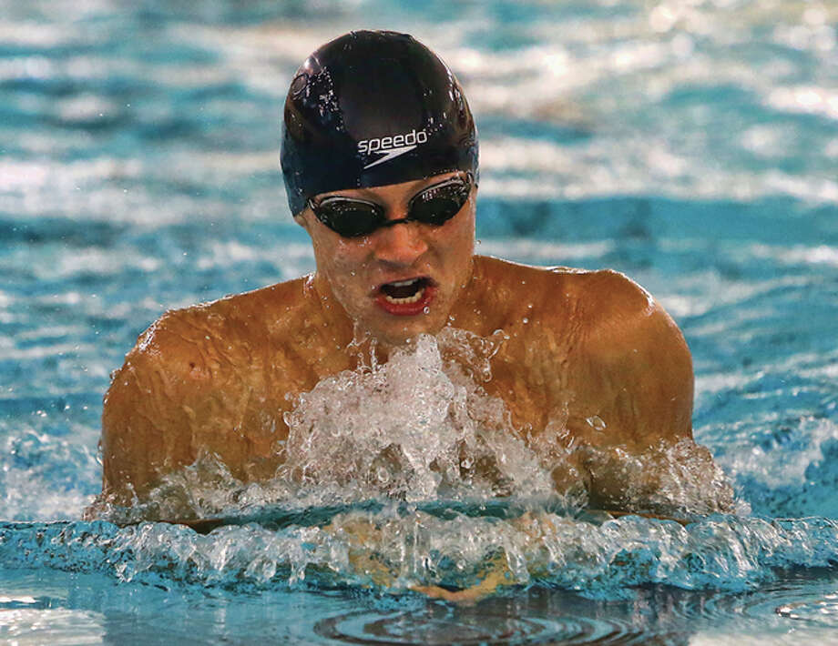 Matthew Costigan of the Edwardsville YMCA Breadkers swims the breaststroke in the 100-meter long course finals Sunday at the Independence Celebration Invitational swim meet at the Chuck Fruit Aquatic Center in Edwardsville. Costigan won the race in 1:09.82. Photo: Scott Kane / For The Telegraph