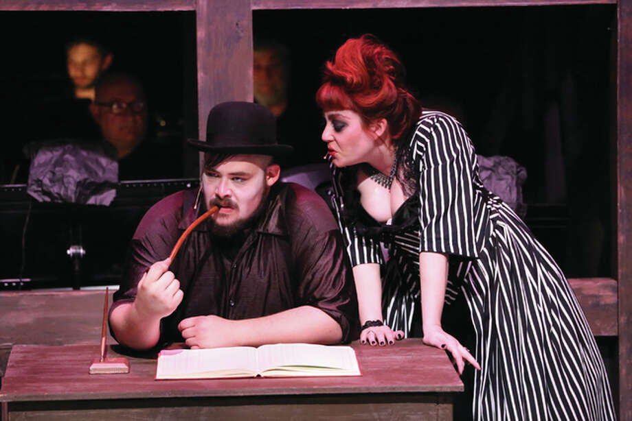 """Mr. Peachum (Zachary Allen Farmer) and Mrs. Peachum (Sarah Porter) make plans, in New Line Theatre's """"Threepenny Opera,"""" with performances now through June 20. Photo: Jill Ritter Lindberg 