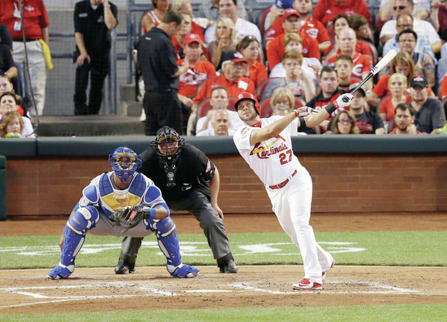 The National League's Jhonny Peralta, of the Cardinals, hits an RBI single in the second inning of the Tuesday night's All-Star game in Cincinnati. Photo: Michael E. Keating | AP Photo