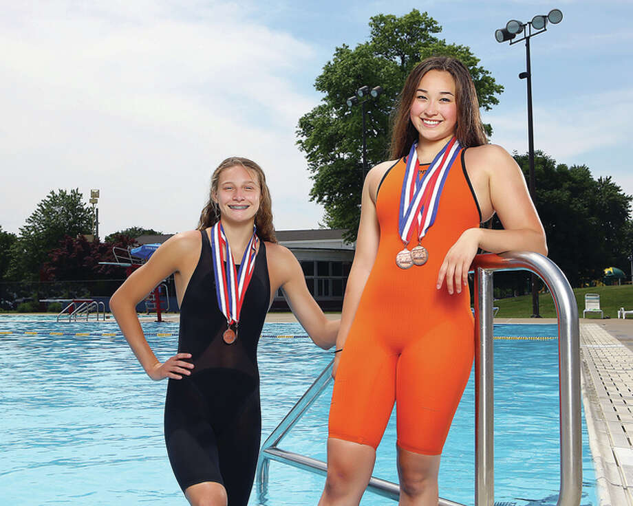 Edwardsville High School's Bailey Grinter, left, and Kate May are The Telegraph 2015 Girls Swimmers of the Year. May advanced to the Illinois State meet in the 100 butterfly and 200 IM, finishing third in the fly. Grinter advanced to State in the 100 backstroke. Photo: Billy Hurst | For The Telegraph