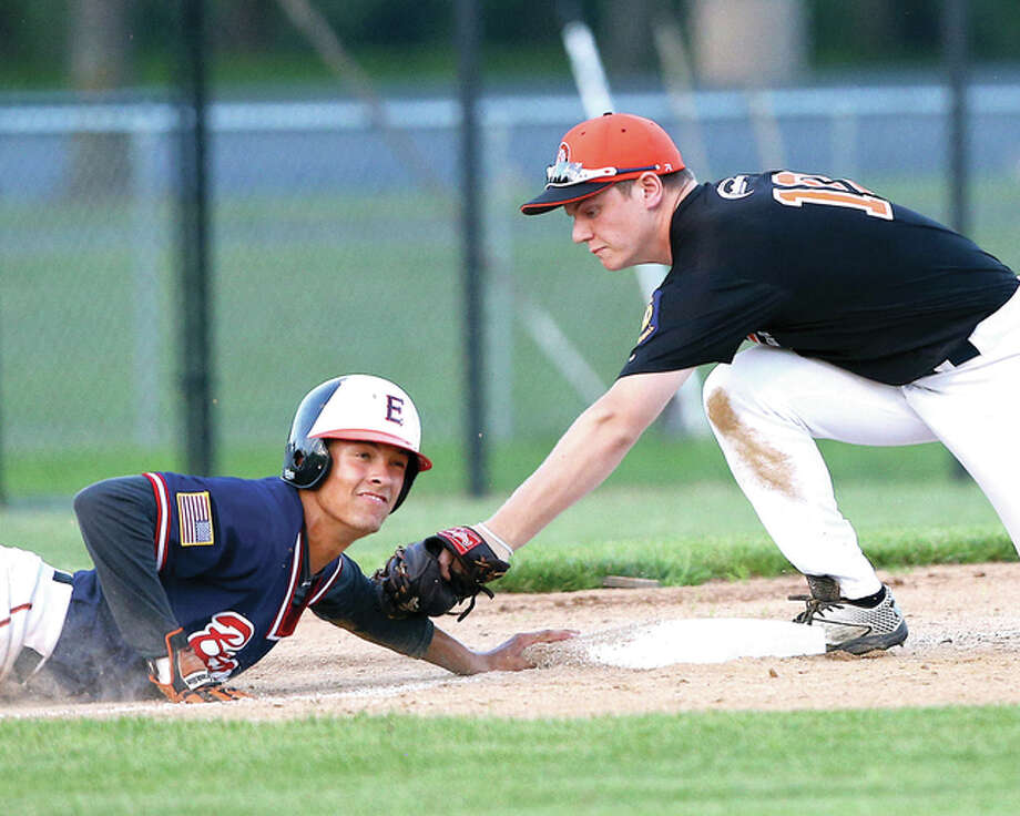 Metro East's Jordan Hovey, left, slides back into third base safely ahead of the tag by Fairview Heights' Blake Deatherage Wednesday night in a District 22 playoff game at Lloyd Hopkins Field in Alton. Photo: Billy Hurst | For The Telegraph