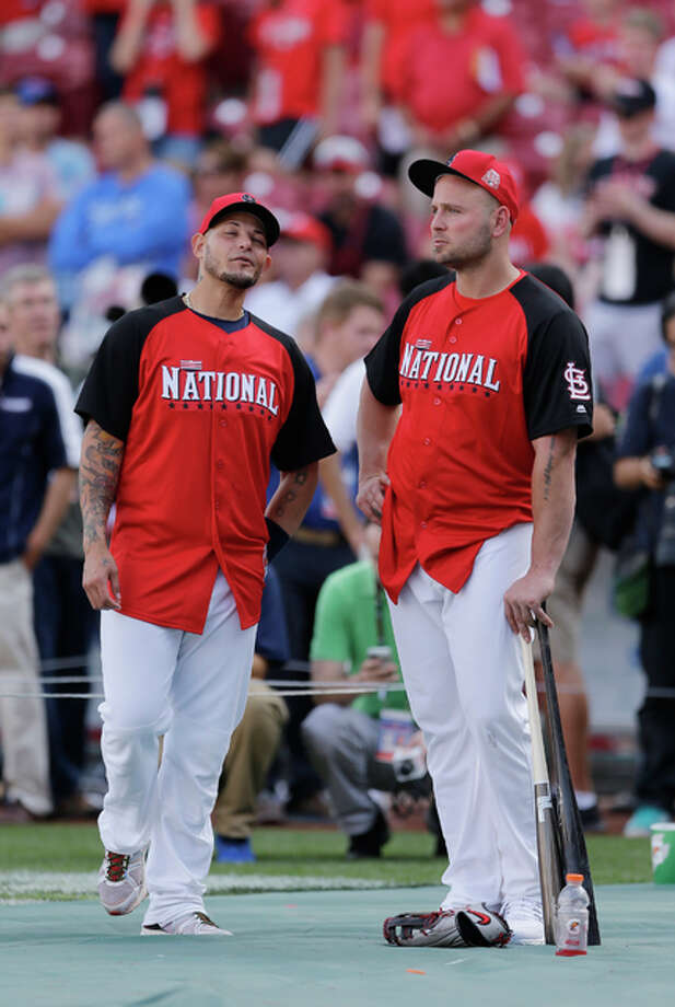 Cardinals Yadier Molina (left) talks with Matt Holliday during batting practice for the MLB All-Star game on Monday in Cincinnati. Photo: Associated Press