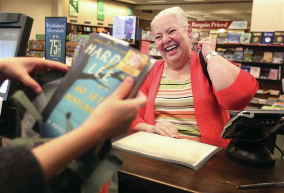 "Bobby Torbert is the first customer to purchase Harper Lee's second novel, ""Go Set a Watchman"" at the local Barnes and Noble on Tuesday in Houston. Harper Lee fans worldwide stayed up late, awoke early and dashed off during meal breaks to pick up a copy of the year's most anticipated novel, ""Go Set a Watchman,"" a second work from the author of ""To Kill a Mockingbird"" that once seemed impossible. Photo: AP 