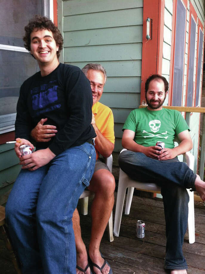 Telegraph executive editor Warren Watson, center, pictured with his sons, James and Sam.