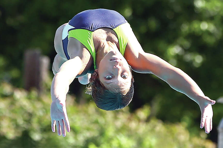 Paige Mouser of the Summers Port Sharks dives during the SWISA Dive Championships Saturday in Godfrey. She placed first in the 11-12 girls division with a score of 123.0. Photo: Bill Hurst | For The Telegraph