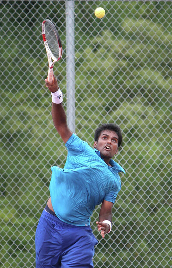 Gandhi Bhakthavachalam serves during play against American Kohlman Lawrence during the first qualifying round of the Lewis and Clark Community College Men's Pro Tennis Classic Saturday at LCCC. Photo: S. Paige Allen | For The Telegrah