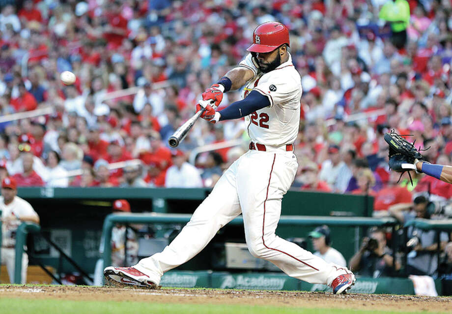 The Cardinals' Jason Heyward hits an RBI double in the fifth inning against the New York Mets SaturdayAT Busch Stadium. Photo: AP