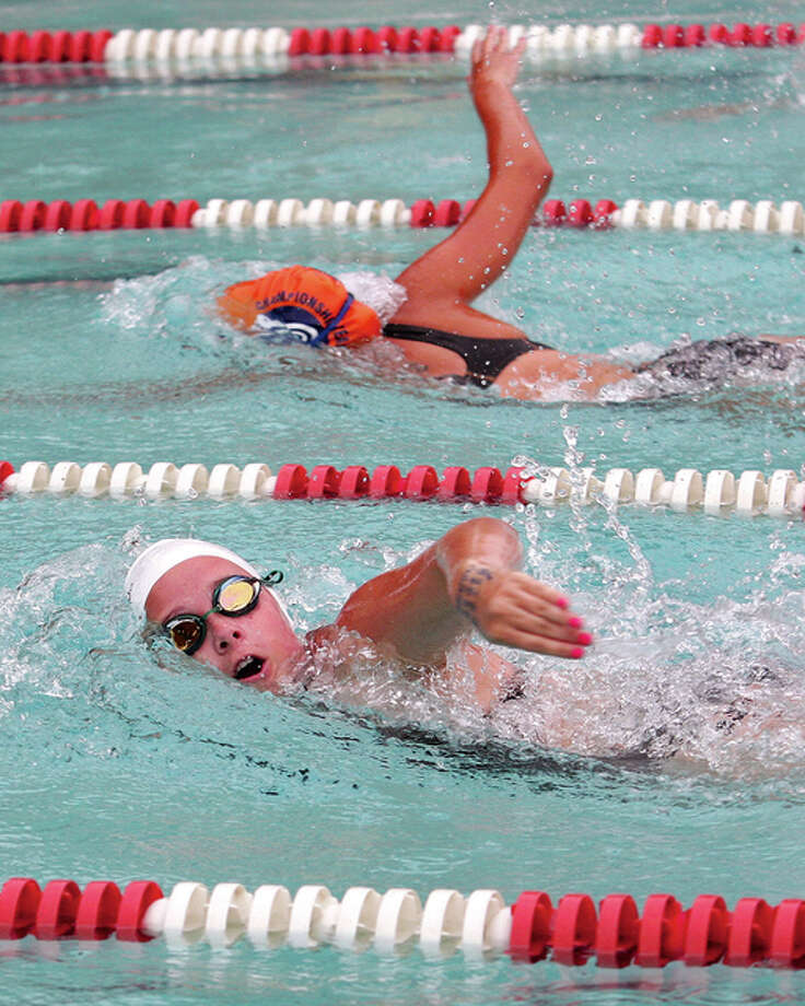 Summers Port's Jenna Fleming (bottom) keeps pace with Paddlers' Emly Webb while swimming the Girls 13-14 200-meter freestyle Sunday morning during the SWISA Championships in Granite City. Photo: James B. Ritter / For The Telegraph