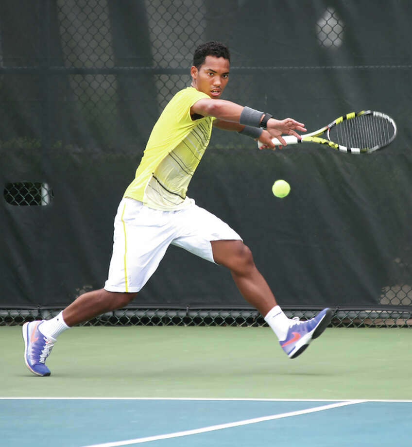 American Gonzales Austin returns a shot during the qualifying round of the Lewis and Clark Community College Men's Pro Tennis Classic, a USTA Men's Futures Pro Circuit Tournament at the Andy Simpson Tennis Complex in Godfrey. Photo: Ariel Weinman / L&C Media Specialist