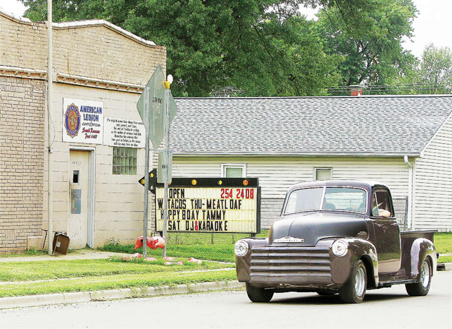 An old Chevrolet truck passes the South Roxana American Legion Post 1167 on Sinclair Avenue. With the exception of a few businesses, the village of about 2,000 people is mostly residential.