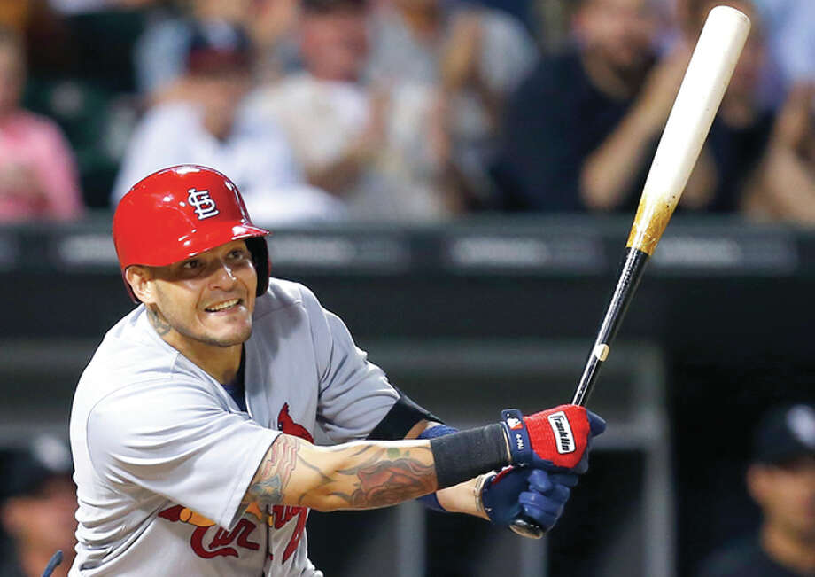 St. Louis Cardinals' Yadier Molina (4) watches his three-run triple during the eighth inning of a baseball game against the Chicago White Sox in Chicago, Wednesday, July 22, 2015. (AP Photo/Jeff Haynes) Photo: AP