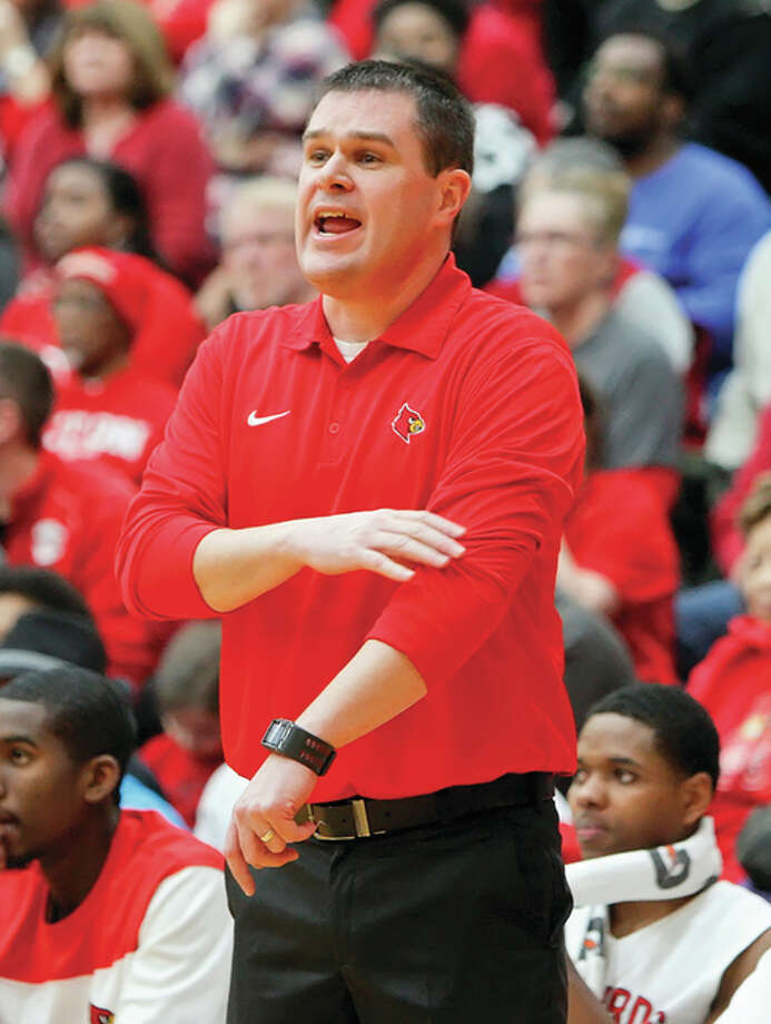 Alton coach Eric Smith led the Redbirds to a 27-5 record, matching the school record for wins, and a Class 4A regional championship to earn 2015 Telegraph Large-Schools Boys Basketball Coach of the Year. Photo: Scott Kane / For The Telegraph