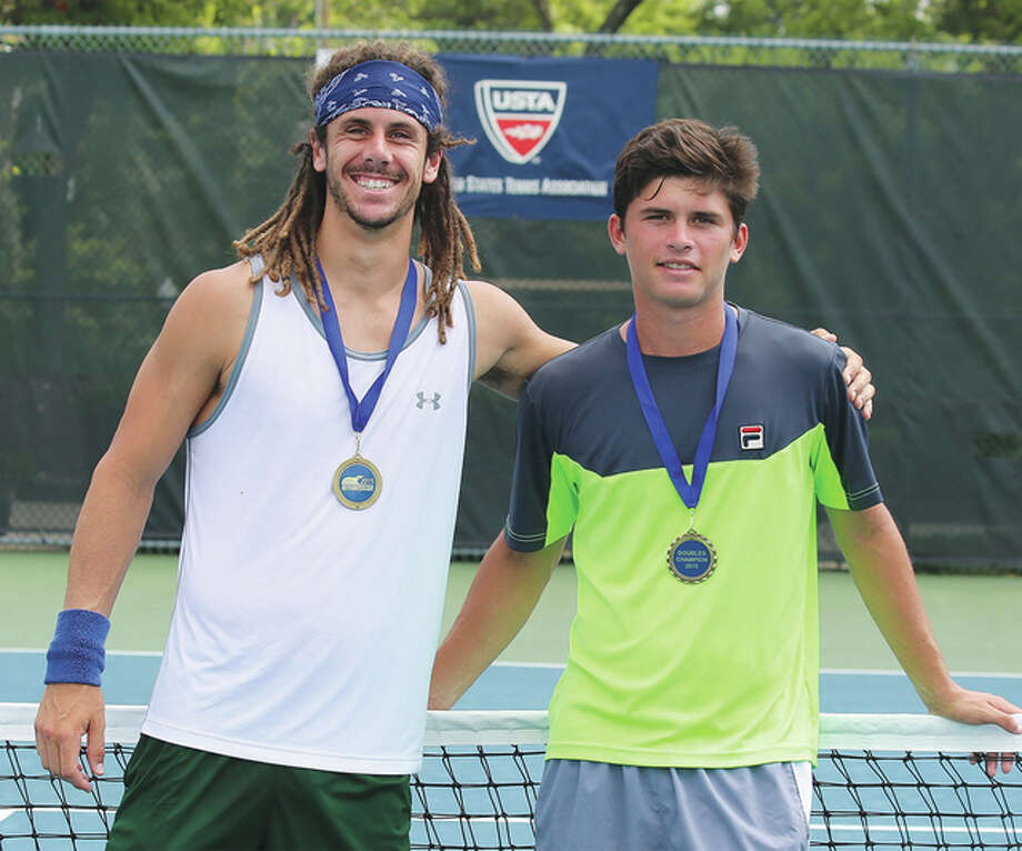 Dominic Cotrone (left) and Jordi Arconada won the doubles championship Friday at the 18th Annual Lewis and Clark Community College Men's Pro Tennis Classic at the Andy Simpson Tennis Complex in Godfrey. Photo: Louise Jett / L&C Media Specialist