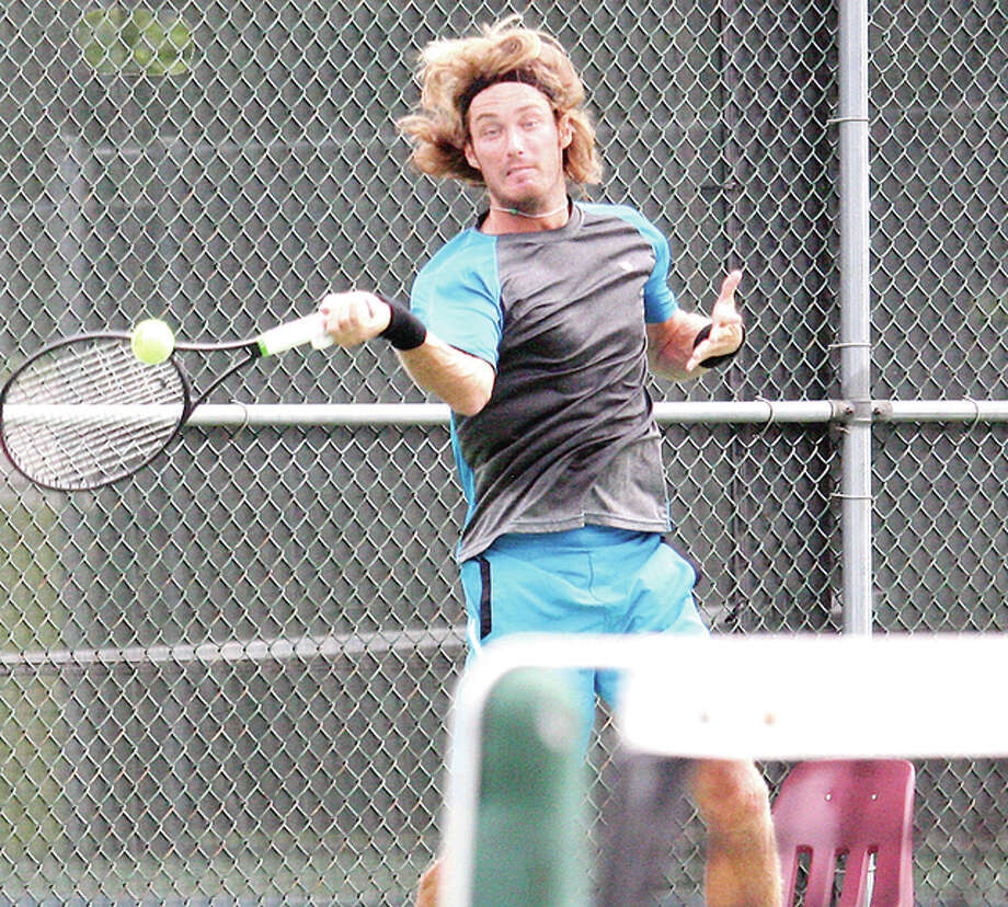 Clay Thompson makes a return during his singles semifinal match against Jared Hiltzik Saturday at the Andy Simpson Tennis Complex at LCCC. Thompson lost 6-2, 6-3. Photo: Daniel Winningham | For The Telegraph