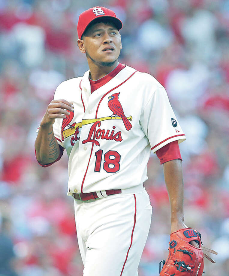St. Louis Cardinals starting pitcher Carlos Martinez walks off the field after striking out the Atlanta Braves' Shelby Miller to get out of a bases-loaded jam in the second inning Saturday at Busch Stadium. Photo: AP