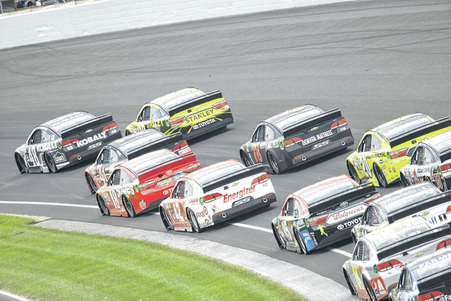 Cars drive through turn No. 1 during the NASCAR Brickyard 400 Sunday at the Indianapolis Motor Speedway. Photo: AP