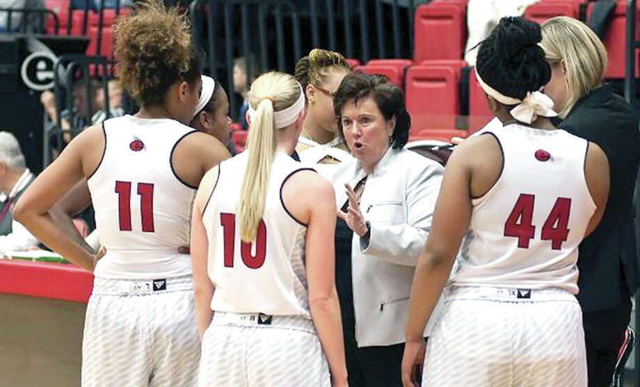 SIUE women's basketball coach Paula Buscher gives her team instructions during a game last season. The Cougars will open the 2015-16 season at home on Nov. 13 against Northern Illinois University. Photo: SIUE Photo